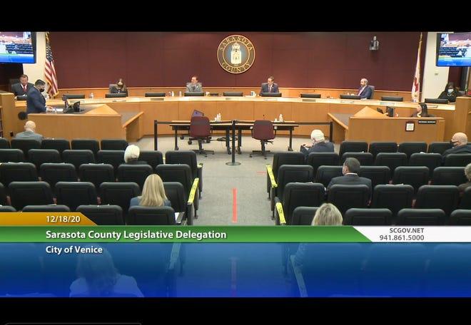 Venice City Council Member Joe Neunder, front row, left, makes his presentation Friday morning to the Sarasota County Legislative Delegation. Delegation members are, from left: Rep. James Buchanan, R-Osprey; Rep. Fiona McFarland, R-Sarasota; Rep. Tommy Gregory, R-Sarasota; Rep. Chairman Will Robinson, R-Bradenton; Sen. Joe Gruters, R-Sarasota; and Rep. Michele Rayner, D-St. Petersburg.