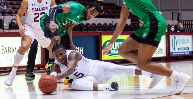 Lance Jones (5) dives for a loose ball during Southern Illinois' victory over North Dakota on Thursday in Carbondale.