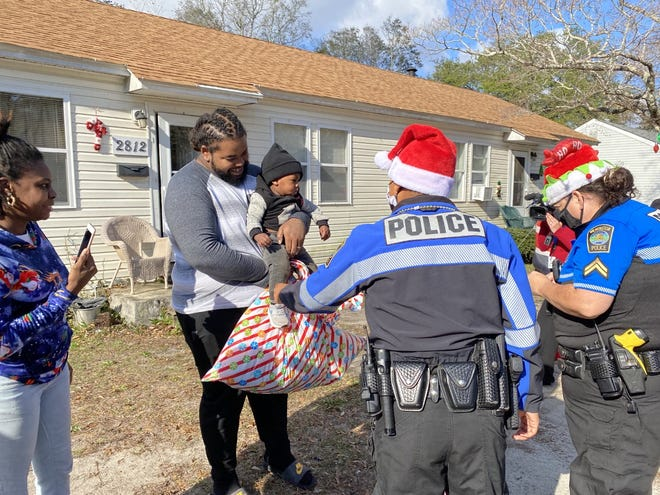 Wilmington Police officers delivering toys in December.