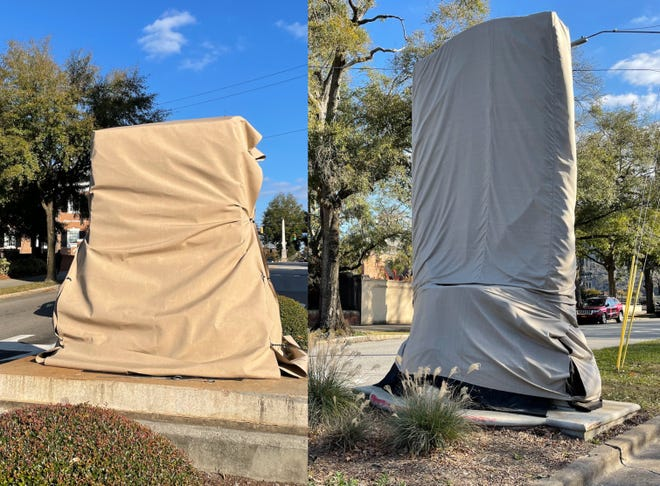 The bases for downtown Wilmington's two Confederate statues, which were removed in June 2020, are now shrouded in khaki coverings as the city continues to discuss what to do with the statues.