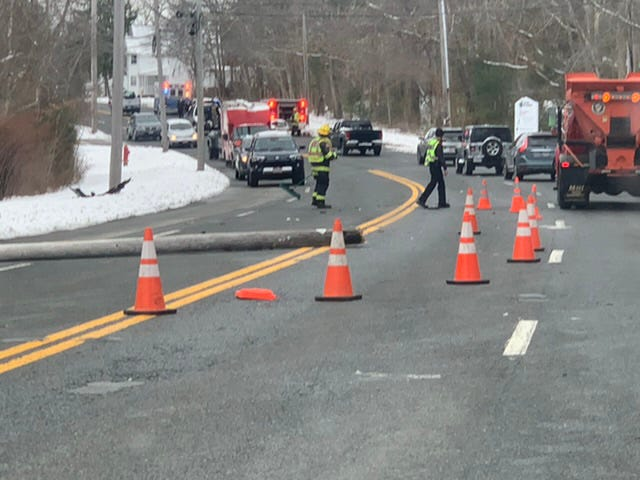 A telephone pole blocks Route 6 in Mattapoisett. The pole was hit by a blue Subaru Friday.