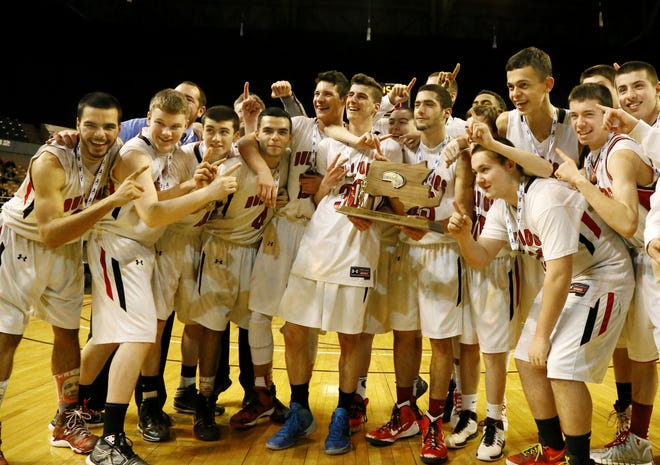 The Old Rochester boys basketball team celebrates on the DCU Center court following its win over the Hoosac Valley Hurricanes in the 2015 Div. 3 state final.
