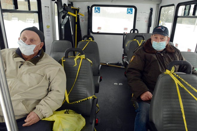 Peter Kendrick of Central Village, left, and Norm Smith of Plainfield ride the Orange Line bus to the Plainfield Town Hall stop Friday. Driver Roland Parent did not pick any new passengers there. [John Shishmanian/ NorwichBulletin.com]