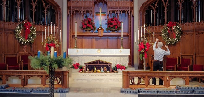Preparations for Christmas services are made at Grace Episcopal Cathedral.