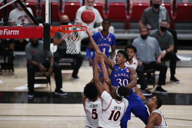 Kansas basketball's Ochai Agbaji attempts a layup during the second half of Thursday's game against Texas Tech at United Supermarkets Arena in Lubbock, Texas. Agbaji, who finished with a game-high 23 points, later scored the go-ahead layup with 12.8 seconds left to give the Jayhawks a 58-57 victory.