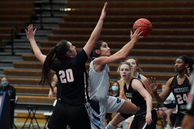 Washburn's Nuria Barrientos drives for a basket against Central Missouri's Graycen Holbert (20) during Thursday's MIAA game at Lee Arena. Barrientos scored 14 to lead Washburn, but Central was too much in a 67-45 win.