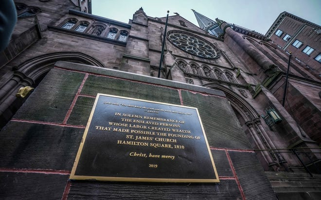 A plaque sits at the steps of St. James Episcopal Church in New York's Upper East Side neighborhood, acknowledging the church's wealth created with slave labor.