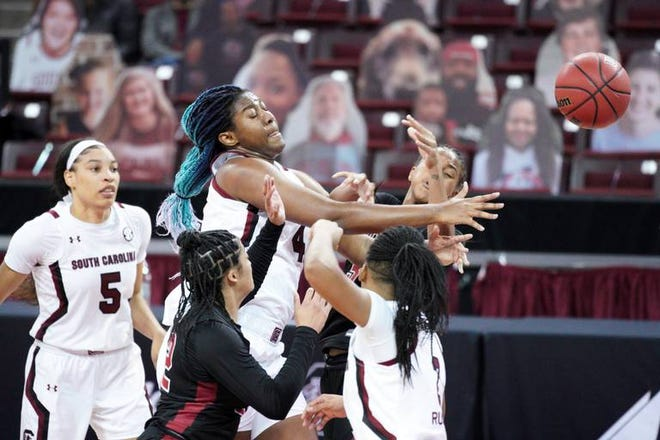 Former Worcester Academy star Aliyah Boston (4) battles for a rebound for South Carolina during Thursday night's game against Temple.