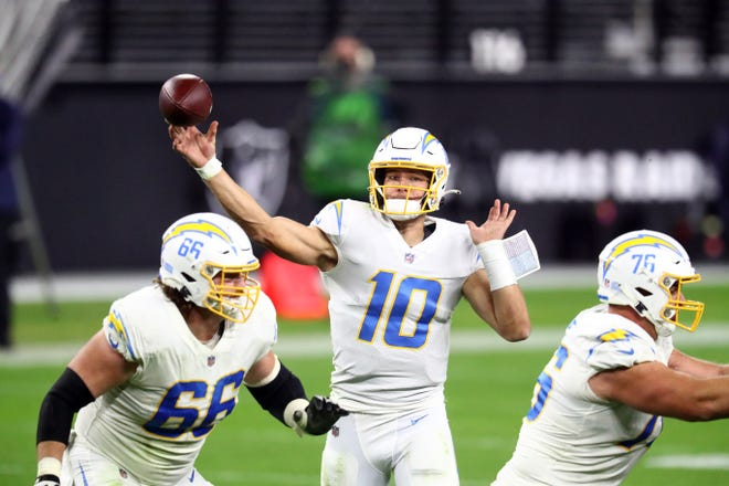 Chargers quarterback Justin Herbert throws during the second half Thursday night against the Raiders.