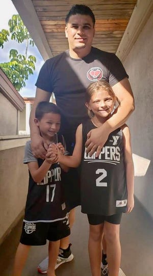 Former Burncoat High star Angel Cirilo and his children, Alonzo, 7, and Gianna, 9.