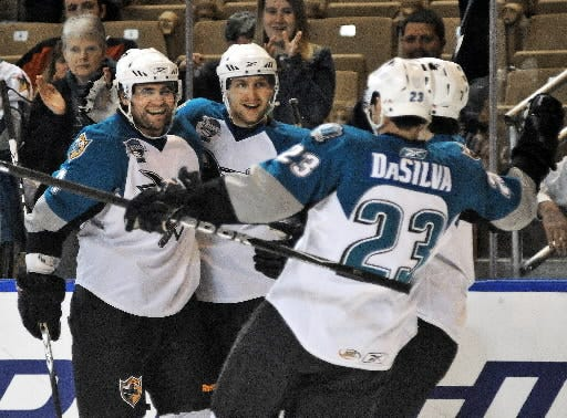 Worcester Sharks defenseman Danny Groulx, left, celebrates a goal with teammates in the 2009-10 season.