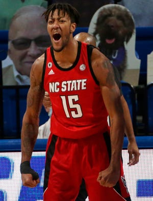 N.C. State's Manny Bates (15), a Fayetteville native, scored a career-high 20 points to go with a career-high eight blocks and seven rebounds at Saint Louis on Thursday.