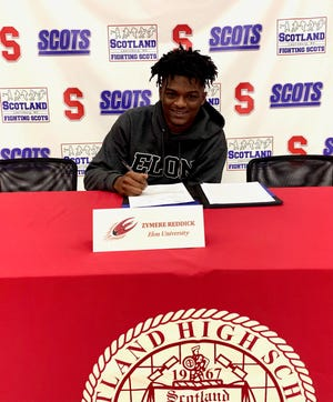 Scotland's Zymere Reddick, one of at least 10 players from the Cape Fear region to sign with a Division I football program on Wednesday, inked his commitment to Elon.