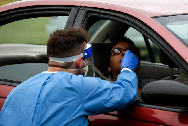A University of Florida medical student conducts a COVID-19 test at Citizen's Field in Gainesville on June 27.