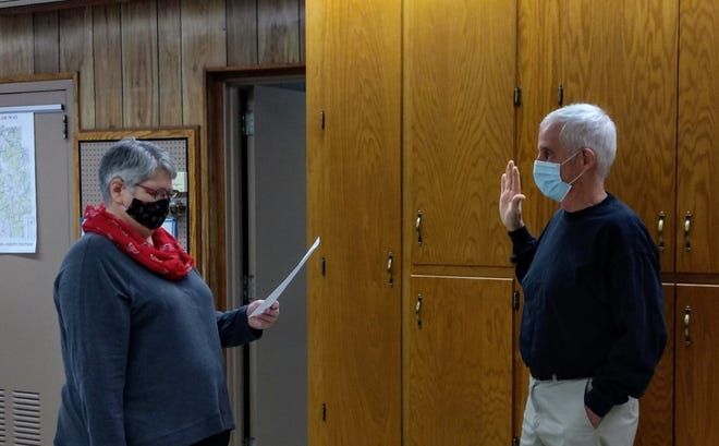 """Joe Bachman was sworn in for his ninth term as Tuscarawas County Engineer by his office manager, Martha Campbell. """"In order to follow Covid Protocol we felt it was best to do a simple ceremony in the office this year,"""" stated Bachman. """"I am honored to again have the opportunity to serve the citizens of Tuscarawas County.'"""