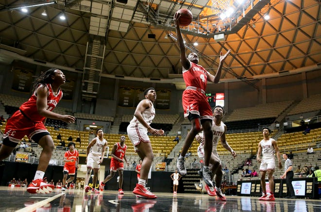 Central's Taveon Goode shoots under the basket against Faith Academy. Central played Faith Academy in the Southwest Regional in the Dunn-Oliver Acadome at Alabama State University in Montgomery Monday, Feb. 17, 2020. [Staff Photo/Gary Cosby Jr.]
