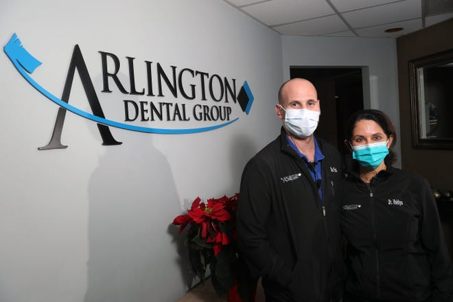 Dr. Mike Fair and Dr. Hetal Vaidya will be moving their practice, Arlington Dental Group, from 3360 Tremont Road to 3380 Tremont Road. Fair and Vaidya, who are married, are receiving a forgivable loan of up to $150,000 from the city to assist with the relocation. The pair are shown at their current location Dec. 17.