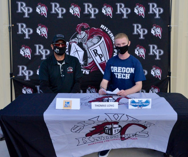 Riverside Prep cross country runner Thomas Long, right, signed a National Letter of Intent at the school Thursday to attend Oregon Institute of Technology next year.