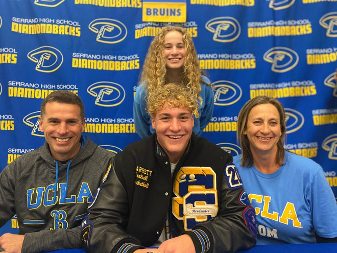 Serrano's Garrett DiGiorgio, center, was surrounded by his family and friends when he signed his National Letter of Intent to play football at UCLA next year.