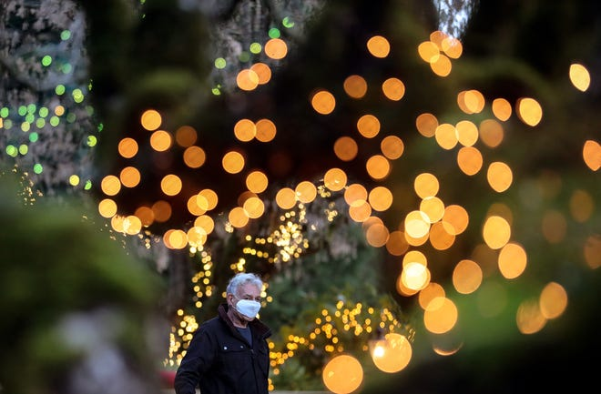 Ron Comin is framed by Christmas lights as he gives a tour of the light display at his home on Big Valley Road in Poulsbo on Dec. 17.