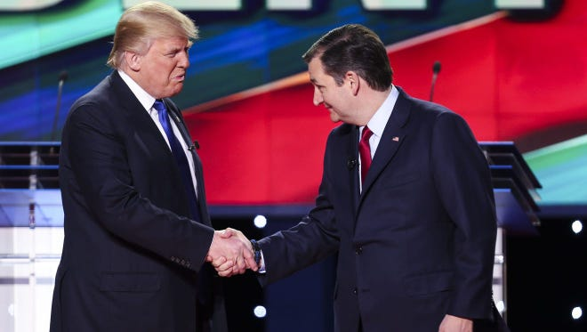 Donald Trump and Ted Cruz shake hands during a Feb. 26, 2016, debate in Houston.