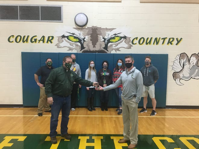 Schalick's athletic department will soon undergo a changing of the guard as Mike Clarke, left, hands the keys to the office to Doug Volovar, who will be taking over as athletic director in April. (Background left to right) Coach John Romano, Coach Sean Collins, Athletic Trainer Leah Franzwa, Secretary Darlene Hunt, Coach Jami Musey-Lau and Coach Turner are part of Schalick's athletic team.