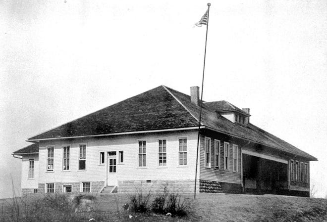 The first Spottsville consolidated school was erected in 1920  and burned  March 9, 1932. It was replaced in less than six months  by a large brick building that was used from 1932 to 1981.  (Photo from the 1929 county-wide yearbook)