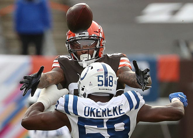 Browns wide receiver Jarvis Landry (80) makes a reception over the head of Indianapolis Colts inside linebacker Bobby Okereke (58) during the first quarter of the NFL week 5 game at First Energy Stadium in Cleveland, Ohio, on Sunday, Oct. 11, 2020. [Jenna Watson/IndyStar]