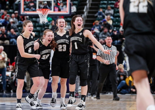 Loogootee Lions jump and hug in celebration after defeating Pioneer Panthers, 45-43, for the IHSAA Class A Girls Basketball State at Bankers Life Fieldhouse, Indianapolis, Saturday, Feb., 29, 2020.