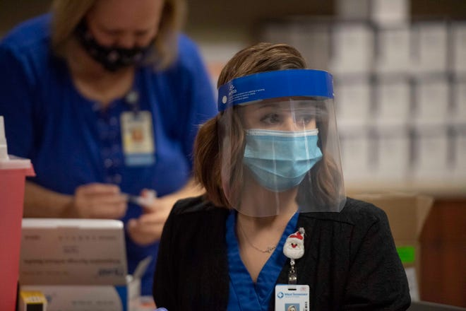 RN BSN Taylor Blankenship was the first nurse to give the Pfizer's COVID-19 vaccine to the health care workers. They were administered at Jackson Madison County General Hospital in Jackson, Tenn., Friday, Dec. 18, 2020