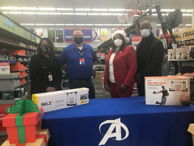 DCS' Courtney Carney, Academy Sports' Steve Johnson and Kimberly Lebby and Derrick Burroughs representing Lane College were all part of a partnership that garnered $3,250 to help foster children have Christmas this year.