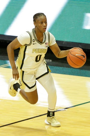 Purdue guard Brooke Moore (0) dribbles during the second quarter of an NCAA women's basketball game, Thursday, Dec. 17, 2020 at Mackey Arena in West Lafayette.