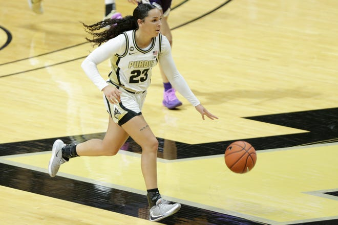 Purdue guard Kayana Traylor (23) dribbles during the first quarter of an NCAA women's basketball game, Thursday, Dec. 17, 2020 at Mackey Arena in West Lafayette.