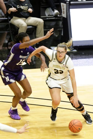 Purdue guard Madison Layden (33) dribbles against Northwestern forward Courtney Shaw (15) during the third quarter of an NCAA women's basketball game, Thursday, Dec. 17, 2020 at Mackey Arena in West Lafayette.