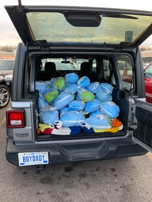 Dekeea Quinney Davis collected frozen turkeys for a Thanksgiving donation, an initiative she, Erica King and Village Lansing saw success from.