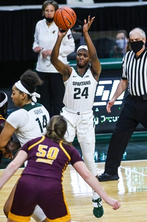 Michigan State's Nia Clouden makes a 3-pointer against Central Michigan during the second quarter on Friday, Dec. 18, 2020, at the Breslin Center in East Lansing.