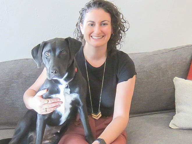 Liz Sniderman and her canine companion, Hershey, love their new home.
