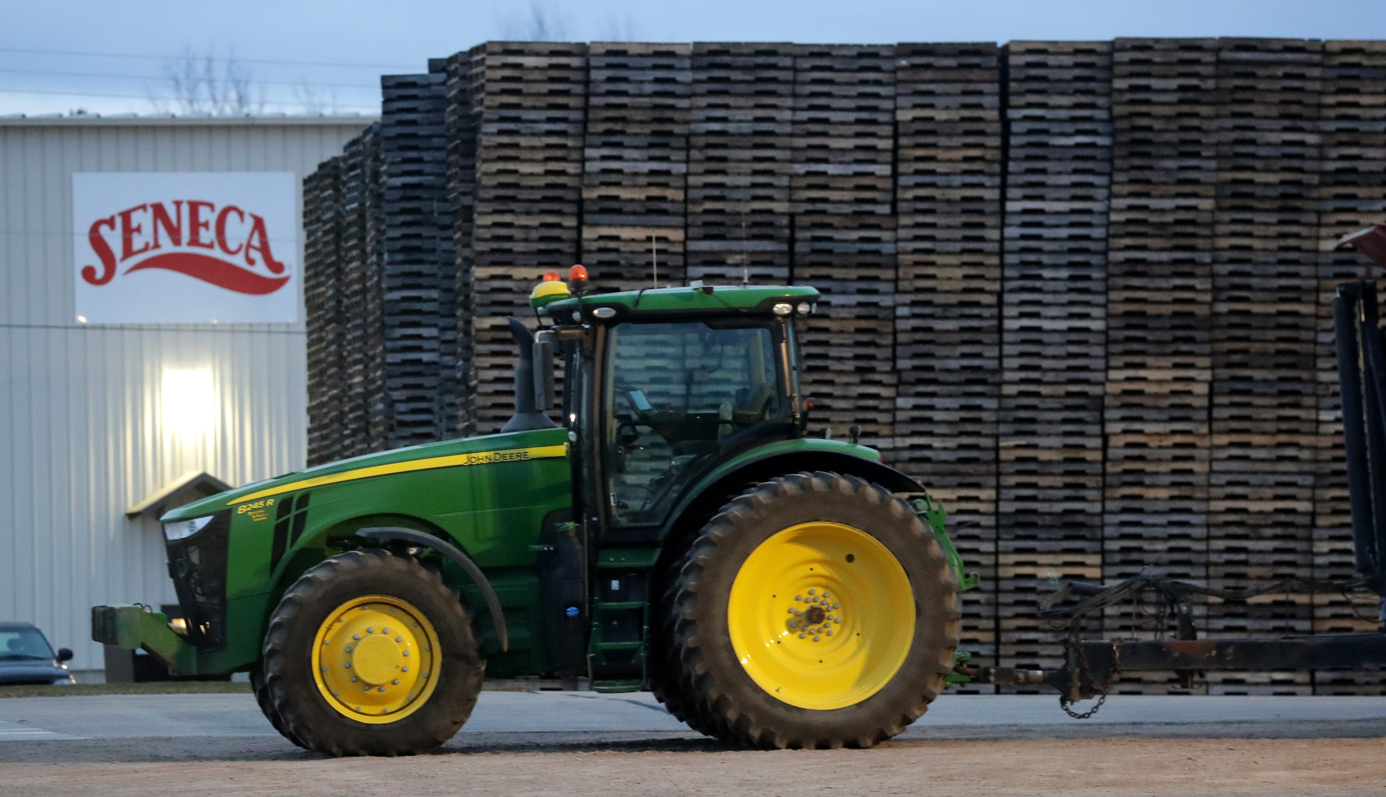 A tractor is parked in front of stacked pallets at the Seneca food plant in Gillett, Wisconsin.
