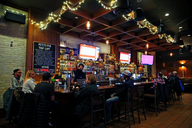 Customers dine while social distancing at Pete's Pub on E. Brady Street. Gov. Tony Evers' administration is asking the Wisconsin Supreme Court to allow state health officials to issue a new order to limit capacity in indoor settings for about a month.