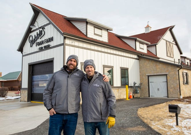 Will Loepfe, left, and Chris Mullett opened the car wash Bubble's Foam Farm in early December.