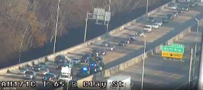 Icy bridges cause several wrecks including one on I-65 near Clay Street.