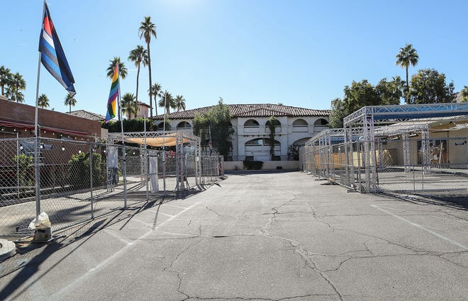 Large outdoor areas outside of businesses on Arenas Road remain empty and closed in downtown Palm Springs, December 18, 2020.