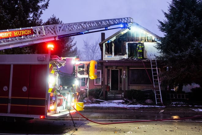 Crews respond to a structure fire in the 900 block of Oak Street Friday morning, Dec. 18, 2020, in Port Huron.