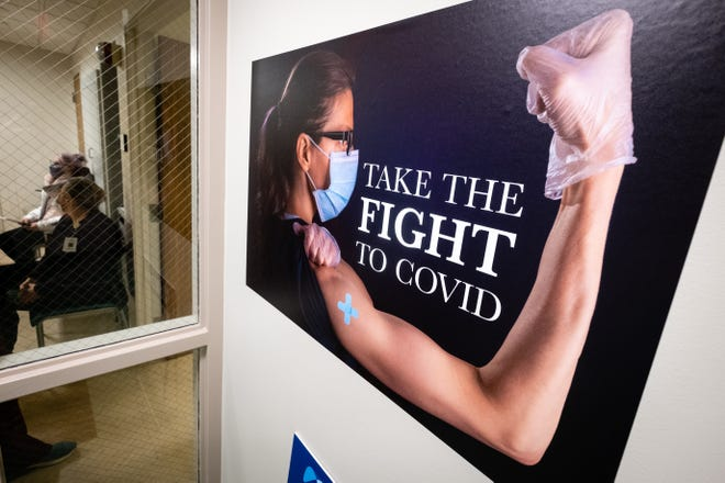 Signs promoting a vaccination for COVID-19 are hung throughout McLaren Port Huron. The hospital received 275 doses Thursday night, and is expecting an additional 50 next week.