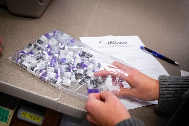 Becky Furtah, McLaren Port Huron's director of pharmacy, unpacks vials of the COVID-19 vaccine Thursday, Dec. 17, 2020, at McLaren Port Huron. The hospital received 275 doses.