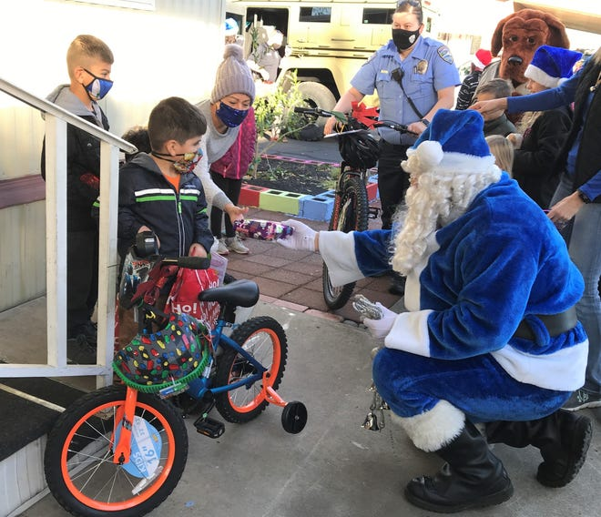 The Blue Santa delivers bicycles and other gifts to Abdiel, Elian and Adolfo on Friday, Dec. 18, 2020, as part of Operation Blue Santa conducted by the Redding Police Department and the Redding Peace Officers' Association.