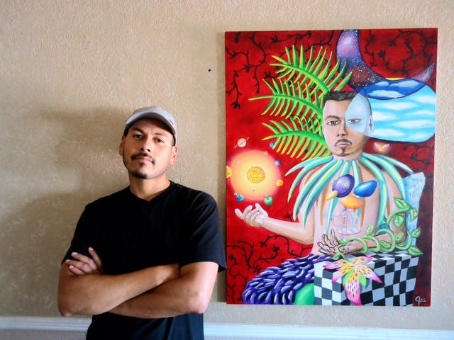 Joe Angel with one of his pieces of artwork.
