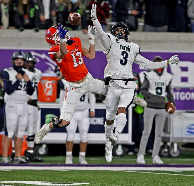 Seth Levesque, left, attempts to make a leaping catch for the Central Bobcats during a playoff game against Eaton on Thursday, Dec. 17, 2020.