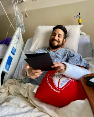 Mike, a patient in the Orthopedic Center at TMH reads a holiday card.