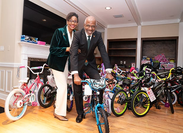 FAMU President Larry Robinson and wife Sharon Robinson with the 90 bikes collected during the annual President's Toy Drive. In all, 1,097 toys, including 90 bikes, were collected this year